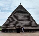 """High hut in South Sudan; A grass & """"thatched pyramid"""", reminiscent of Kushitic connection."""